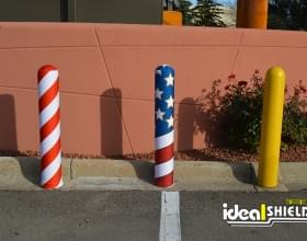 Ideal Shield's yellow plastic Bollard Covers with two covered in AdShields
