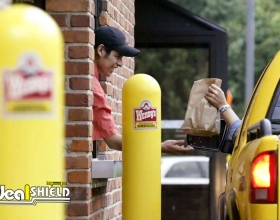 """Ideal Shield's yellow plastic 1/4"""" Bollard Covers with custom decals in Wendy's drive-thru"""