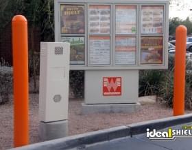 "Ideal Shield's 1/4"" orange Bollard Covers at Whataburger's drive-thru"