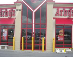 """Ideal Shield's 1/4"""" yellow Bollard Covers at Arby's drive-thru"""