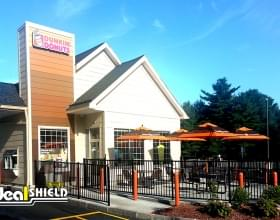 "Ideal Shield's 1/8"" orange bollard covers at Dunkin Donuts"