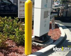 "Ideal Shield's 1/8"" yellow plastic bollard cover at McDonald's guarding the drive-thru speaker"