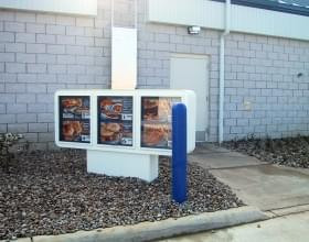 "Ideal Shield's 1/8"" blue bollard covers at a Culver's drive-thru"