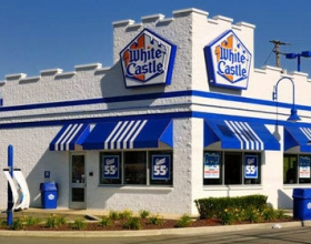 "Ideal Shield's 1/8"" blue bollard covers at a White Castle drive-thru"