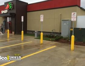 Ideal Shield's yellow Bollard Sign Systems used for Chili's curbside pickup parking spots