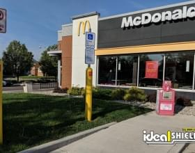 Ideal Shield's yellow plastic Bollard Sign Systems with custom logo used for designated parking spots at McDonald's