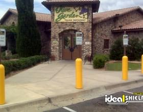 Ideal Shield's Yellow Bollard Sign System used for Reserved Parking at Olive Garden