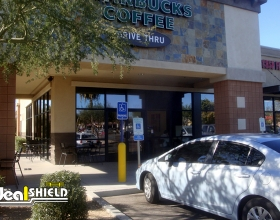 Ideal Shield's Bollard Sign Systems used for Starbucks handicap accessible storefront parking spots