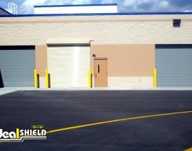 """1/8"""" Bollard Sleeves Protecting Garage Door"""