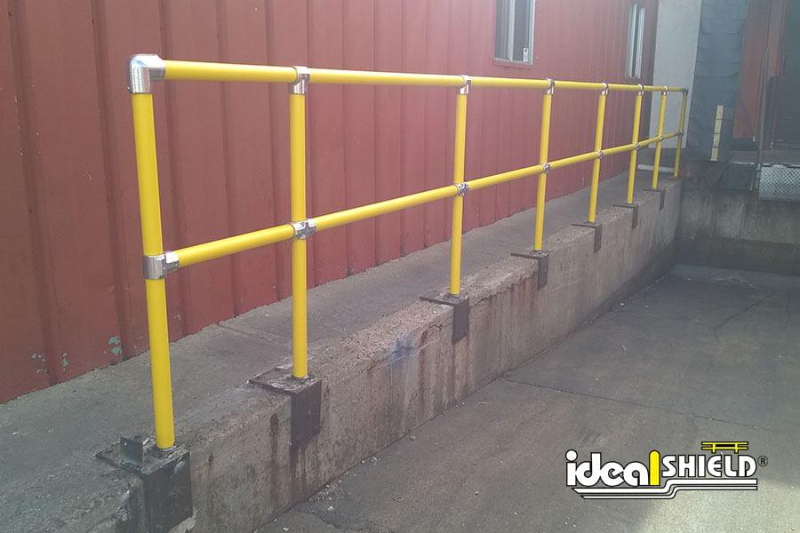 Steel Pipe and Plastic Handrail along loading dock entrance
