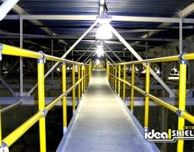 Ideal Shield's yellow Steel Pipe and Plastic Handrail in the rafters