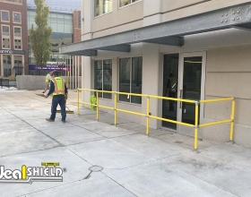 Ideal Shield's yellow Steel Pipe and Plastic handrail at Little Caesars Arena in Detroit, Michigan