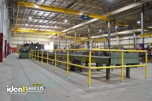 Ideal Shield's yellow Steel Pipe and Plastic handrail in a steel fabrication shop