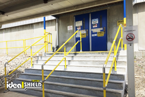 Ideal Shield's Steel Pipe & Plastic Handrail up a flight of stairs