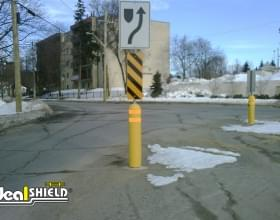 Yellow Bollard Sign System Applied To Traffic Sign