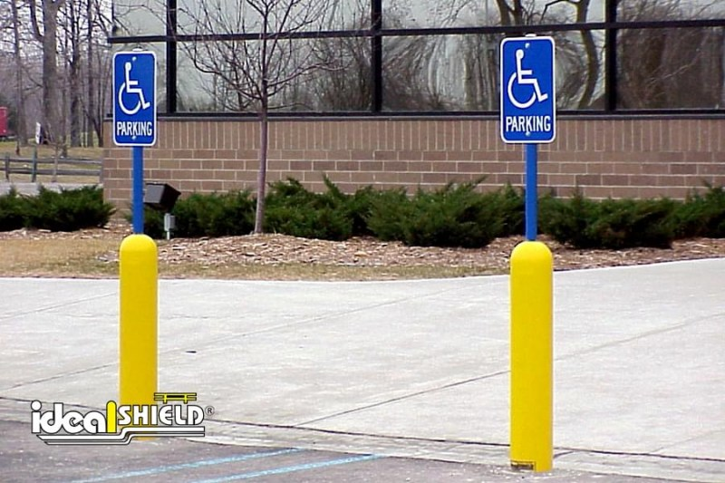 Ideal Shield's eight inch Yellow Handicap Bollard Sign System with Blue Sign Posts