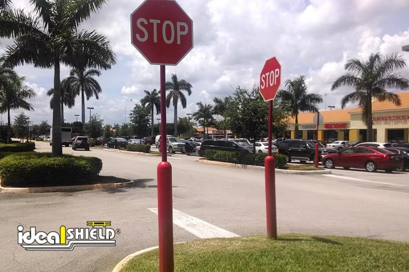Ideal Shield's four inch Red Bollard Sign System used as Stop Signs at an Intersection