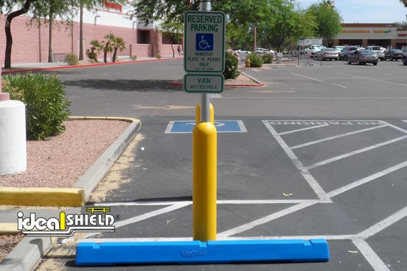 Ideal Shield's six inch Yellow Bollard Sign Systems used for handicap accessible parking