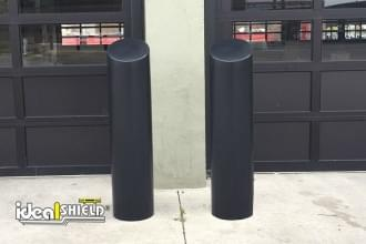 "Garage doors protected by our 10"" Skyline Bollard Cover"