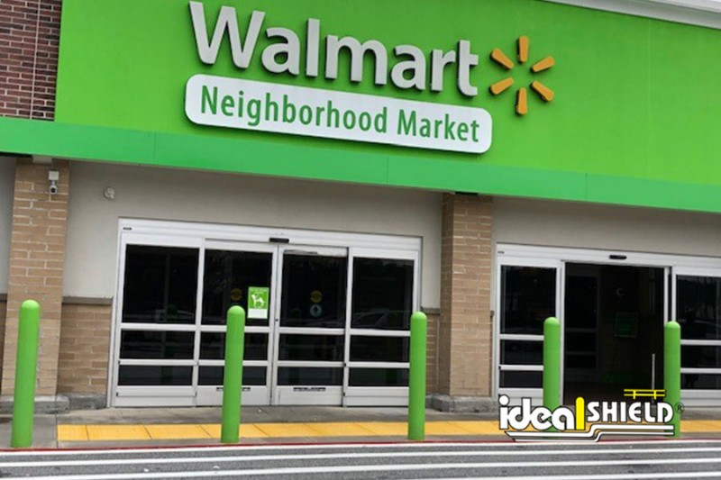 Ideal Shield's bollard covers branded to match Walmart Neighborhood Market's color scheme