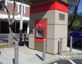 Custom gray bollard covers with red reflective tape to match Bank of America's corporate colors