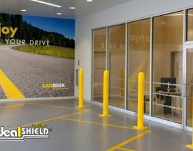 Yellow bollard covers matching in-store CarMax rental facility