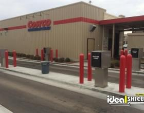 Costco using red bollard covers for parking lot branding