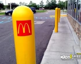 McDonald's logo added to yellow bollard covers