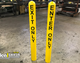 Ideal Shield's bollard covers with Exit Only and Enter Only lettering