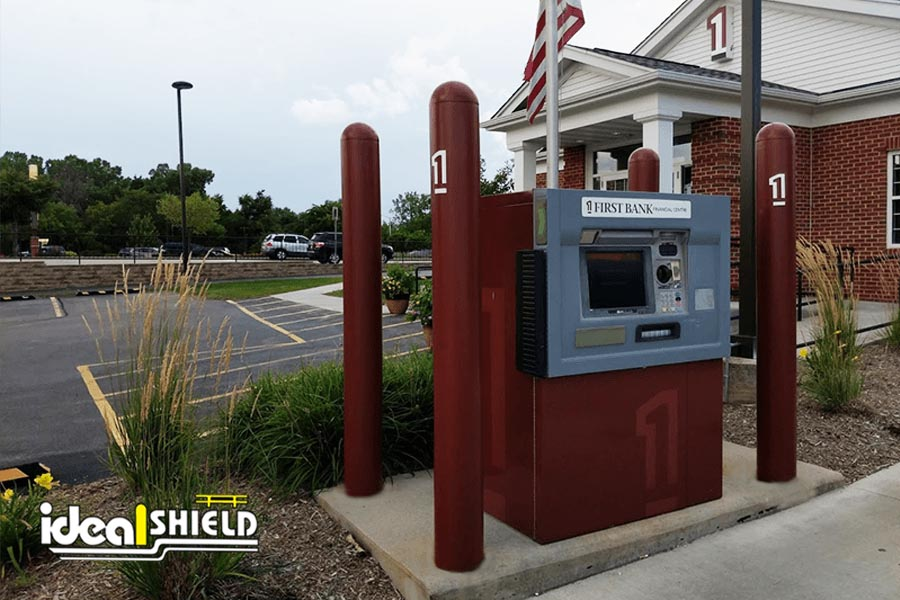 Ideal Shield's custom brown Bollard Covers with bank logo at ATM kiosk