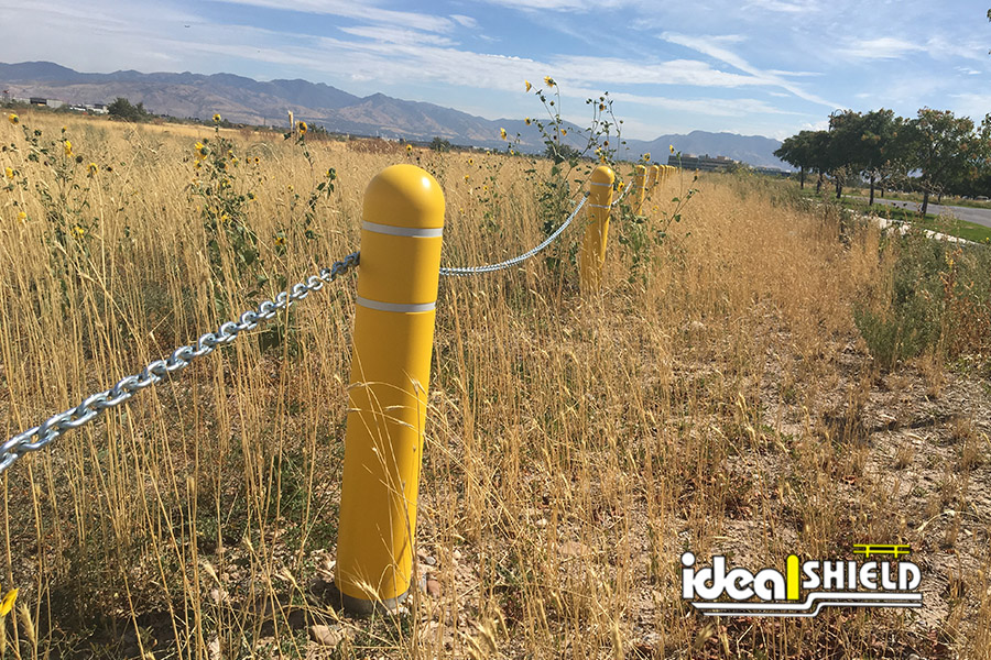 Ideal Shield's Reflective Bollard Covers with chains attached