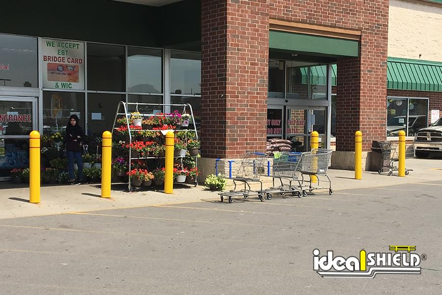 Ideal Shield's Bollard Covers with reflective tape in front of a grocery store