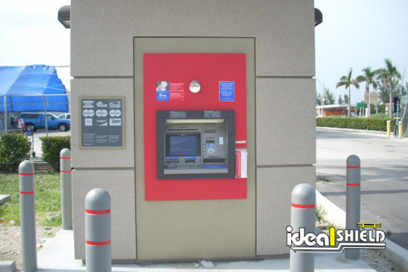 Ideal Shield's Gray Reflective Bollard Covers with Red Tape surrounding a Bank of America ATM