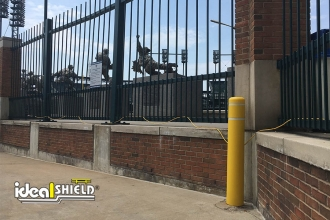 "Ideal Shield's 6"" flat top bollard covers with reflective white tape at Comerica Park"