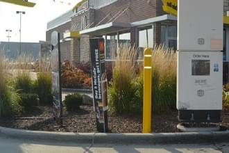 Ideal Shield's Reflective Bollard Cover used for drive-thru protection at McDonald's