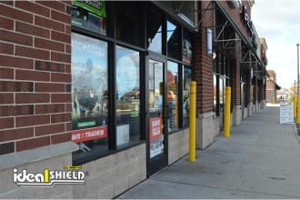 Ideal Shield's Reflective Bollard Covers outside of a store