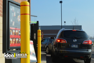 "Ideal Shield's 4"" flat top bollard covers with reflective red tape at McDonald's"
