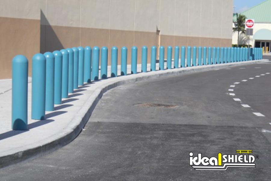 Ideal Shield's bollard covers lined alongside the road by a facility