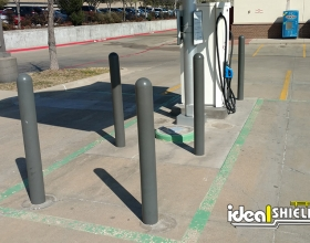 Ideal Shield's Bollard Covers used to guard a gas station's electric vehicle charging station