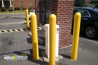 Yellow 1/4 Inch Bollard Sleeves Gated Entry