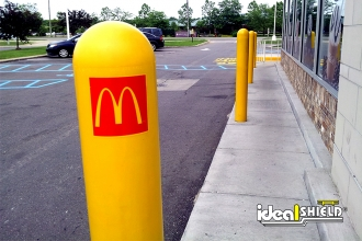 Ideal Shield's 1/4 Inch Custom Logo Bollard Covers used at McDonald's