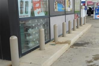 1/4 Inch Bollard Covers Protecting Storefront