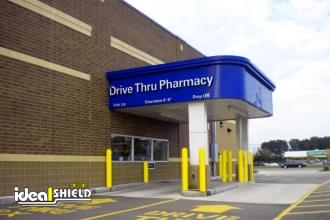 Bollard Cover Protecting Pharmacy Drive Thru