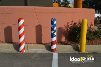 Ideal Shield's bollard covers with American Flag and Candy Cane AdShield fabric covers