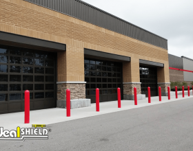 Pedestrian walkway protection with red bollard sleeves at Costco