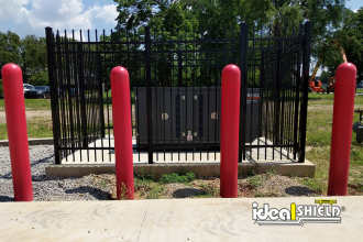 Ideal Shield's red bollard covers protecting a critical asset