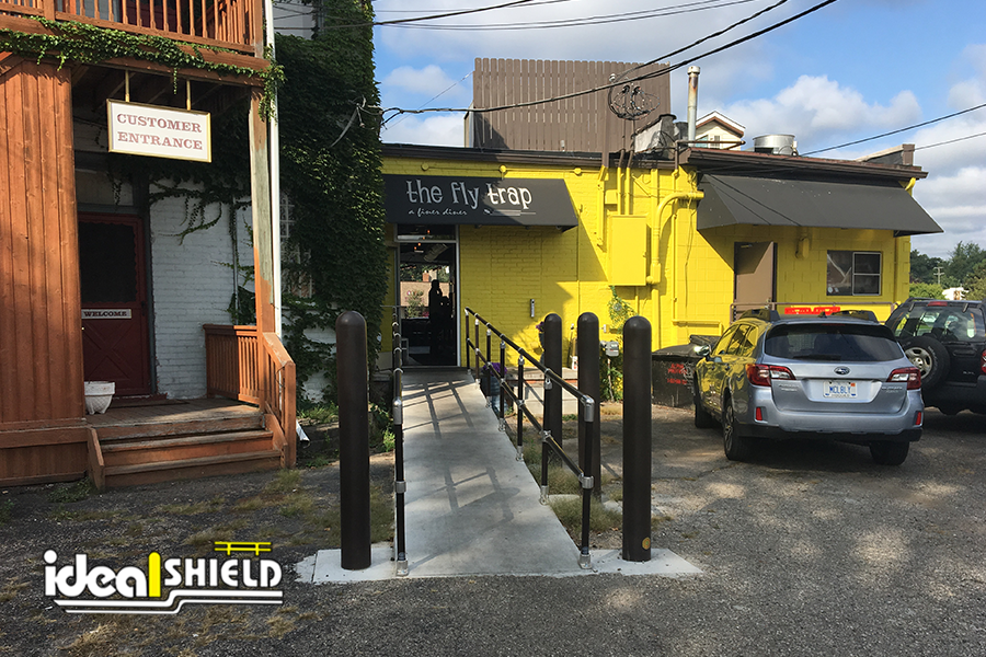 Ideal Shield's bollard covers and handrail for a restaurant's handicap accessible ramp entrance