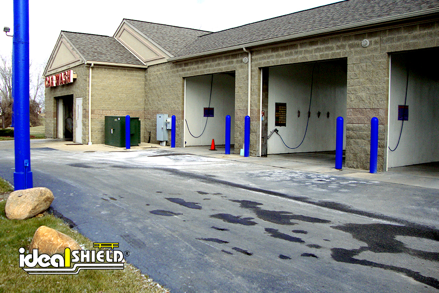 Car Wash Garages Shielded With Blue Bollard Covers