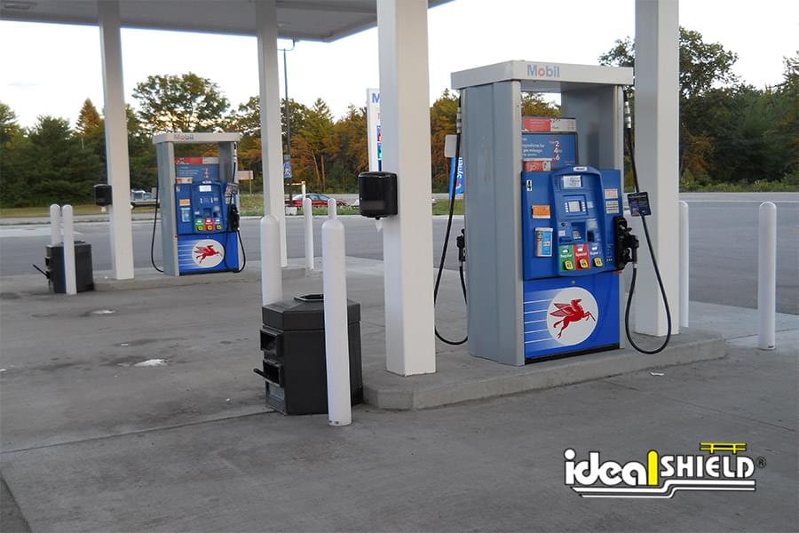 """Ideal Shield's 1/8"""" Bollard Covers protecting gas pumps"""