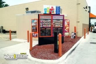 "Ideal Shield's 1/8"" Bollard Covers used for protection at a Dunkin Donuts drive-thru"